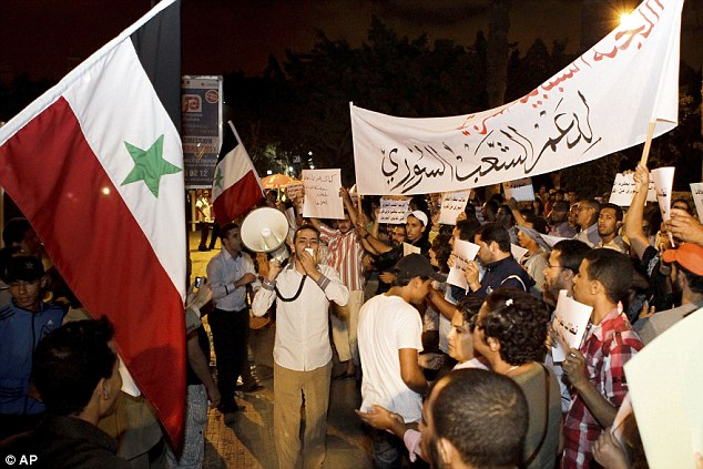 Anti-Assad supporters pictured on Thursday in Casablanca