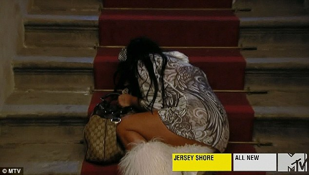 Inconsolable: Snooki collapsed in a heap on the steps to her apartment after failing to work things out