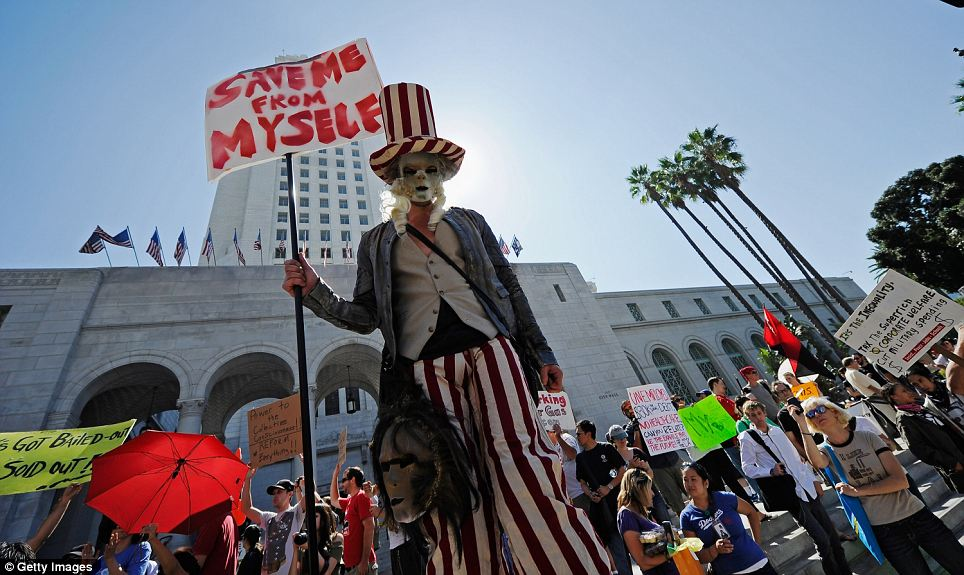 Bold statement: A protester wears some eye-catching garb as he demonstrates in Los Angeles
