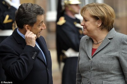 Merkel, seen here with Nicholas Sarkozy in Strasbourg yesterday, is seen to symbolise the success of German reunification
