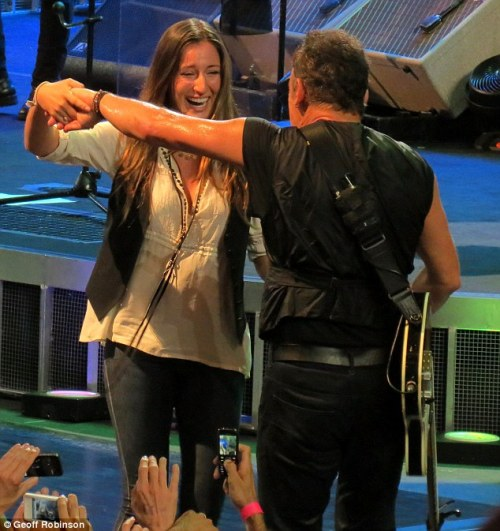 Having a ball: Springsteen pulled his 20-year-old daughter Jessica on stage during a rendition of his iconic hit song Dancing in the Dark