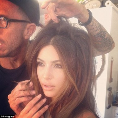 Stylist to the stars: Kim posted a photo of her having her hair done by Hollywood hairdresser Chris McMillan