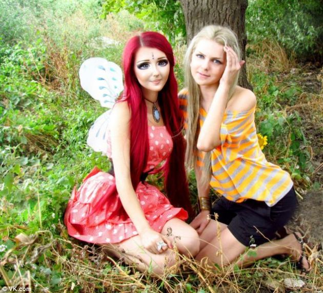 'Flower fairy': Shpagina sports a pair of fairy wings as she poses with a more natural-looking girl