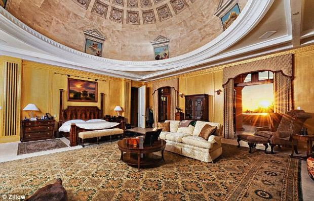 A magnificent domed ceiling frames this master suite