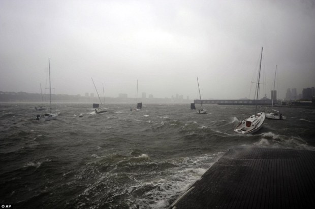 Sailboats rock in choppy water at a dock along the Hudson River Greenway as one thousand more troops have been drafted in