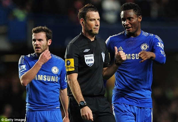 Centre of the storm: Referee Mark Clattenburg and Chelsea midfielder John Obi Mikel