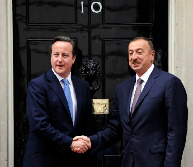 Ruling friend: British Prime Minister David Cameron shakes Ilham Aliyev's hand on the steps of No.10 Downing Street in August this year