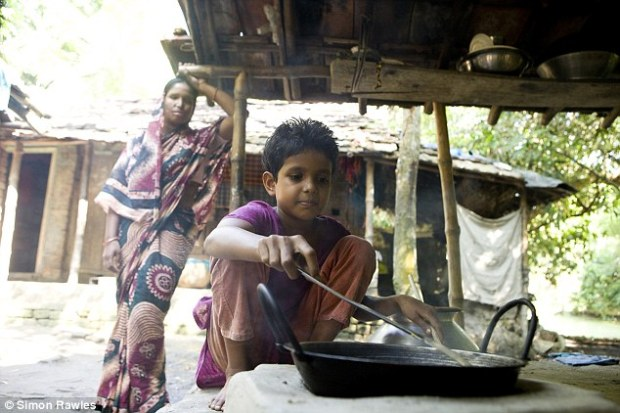 Devastating: Nurbanu's daughter is seen cooking for her mother, who is no longer able to prepare a meal following the acid attack
