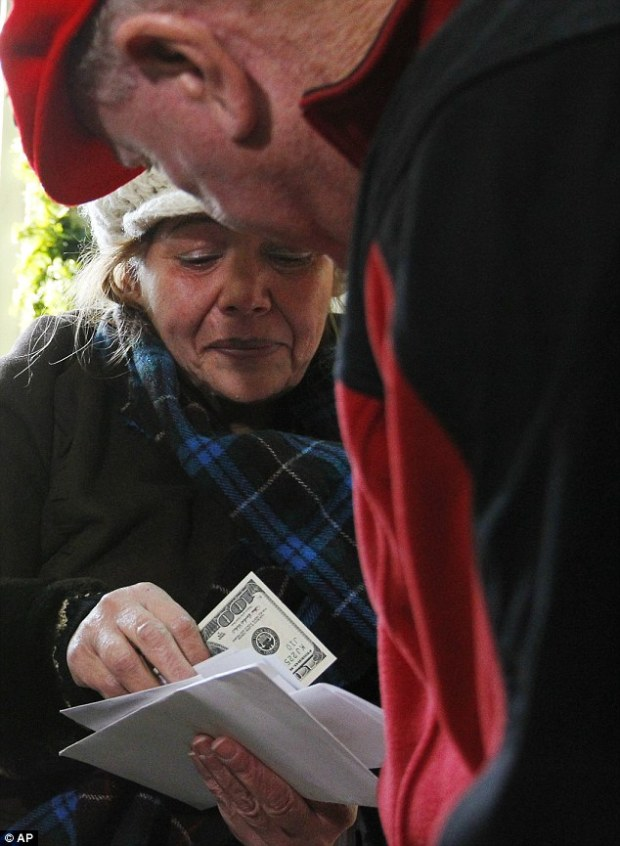 Sharing: The Missouri man, who doesn't want to be identified, is making it his mission this holiday season to distribute $100,000 to those less fortunate