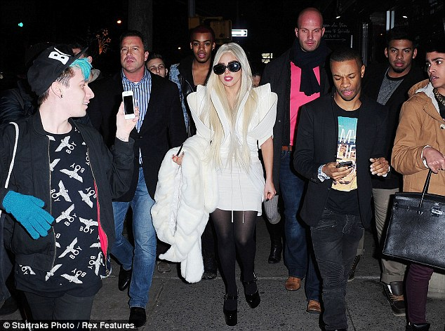 Little monsters: It may have been late, but Gaga is always surrounded by a huge entourage