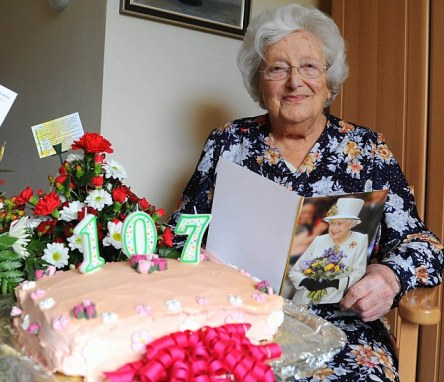 Fighting fit: Mary Snelling has celebrated her 107th birthday with friends and with a card from the Queen - and says the secret is an apple a day
