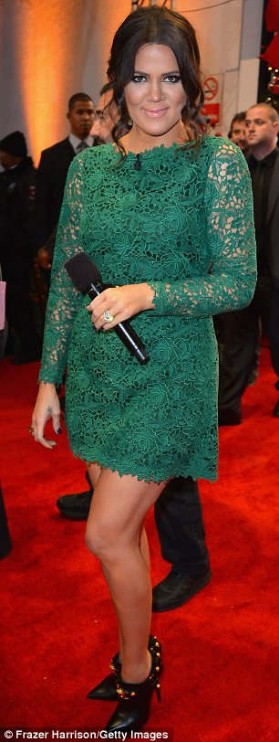 Lovely in lace: Khloe made for an arresting sight in her green lace dress which showed off her long legs