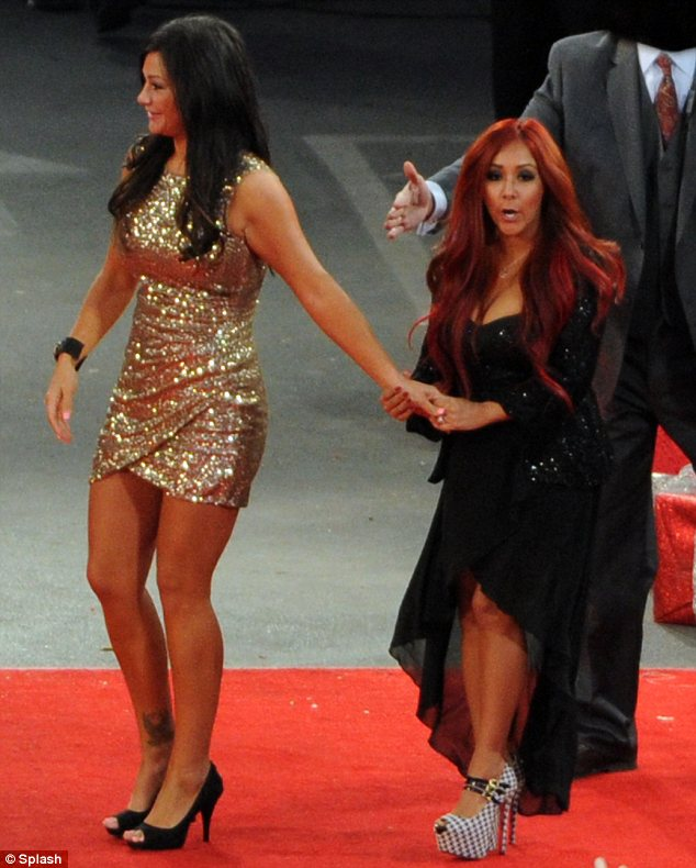 Feeling festive: JWOWW and Snooki looked in the mood to party in their sequined dresses