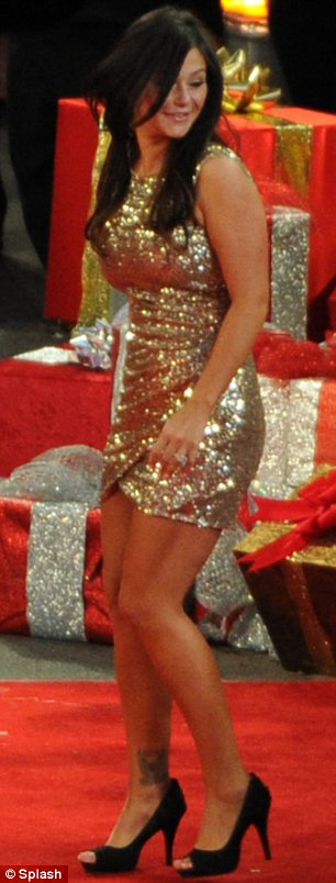 Golden ticket: JWOWW shimmered her way down the red carpet which was lined with Christmas trees and presents