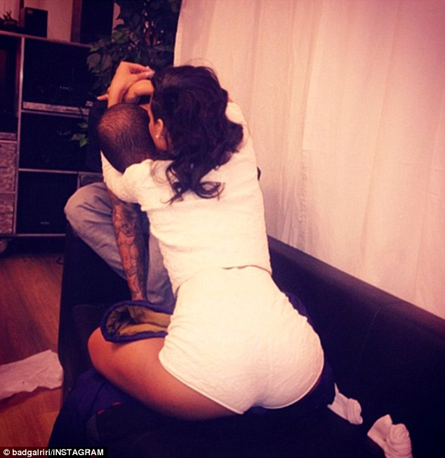 Tender: Rihanna posted an eyebrow-raising shot of herself planting a kiss on Chris in a nuzzling embrace