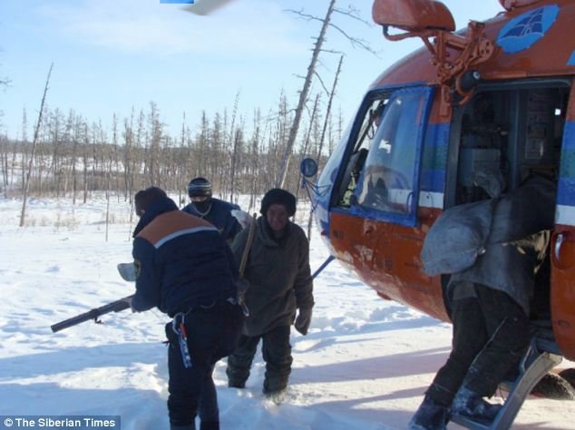Rescue: Alexander Abdullayev makes his way to a Russian search helicopter