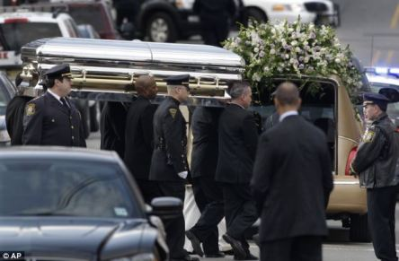 Tragedy: The singer' is carried to a hearse in a coffin after her funeral in Newark, N.J., in February