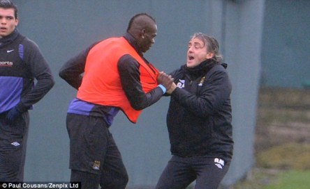 Push and pull: Mancini and Balotelli raged at each other