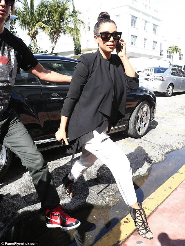 Miami nice: Kim Kardashian stepped out with Jonathan Cheban while in Florida for a photo shoot on Monday