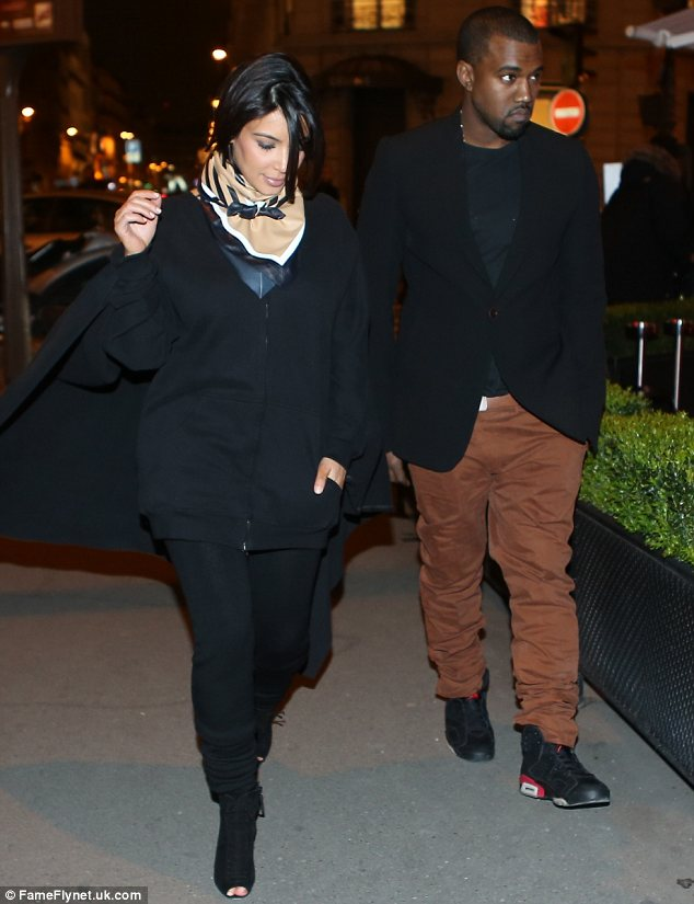 Home sweet home: Kim Kardashian and Kanye West, seen in Paris together on Tuesday, have purchased their first house together