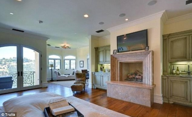 Huge: Another lounge area features marble fireplaces