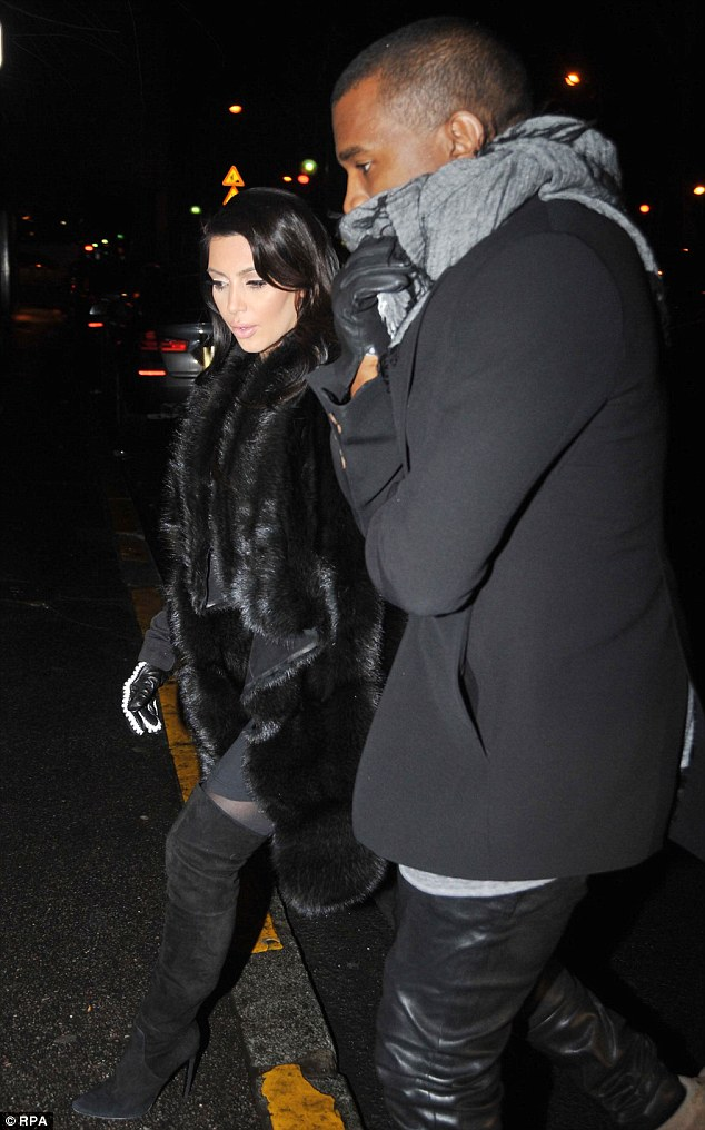 Stepping out: Kim Kardashian and Kanye West were spotted having dinner at Lasserre restaurant in Paris on Tuesday night