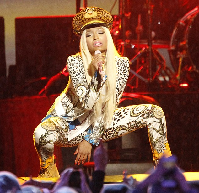 That's some outfit: Nicki Minaj wore a garish Roberto Cavalli outfit for her performance on Jimmy Kimmel