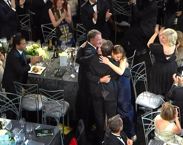 Hugs all round: As people got up to hug the young star her dress got snagged on a chair