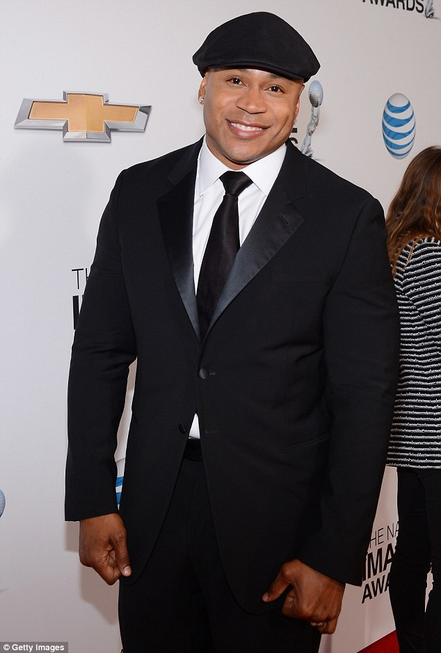Ready for his close up: LL Cool J donned a black suit with satin lapel and a cheese cutter cap