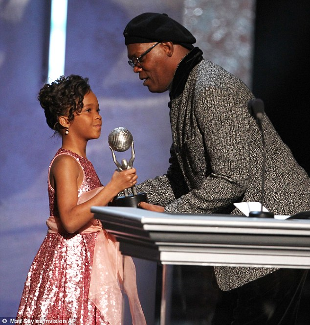 Heavy lifting: Samuel L. Jackson helps the tiny actress hold the award
