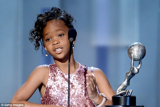 Shoe stealer: Quvenzhane Wallis accepts the award on behalf of Viola Davis for her role in Won't Back Down
