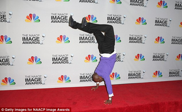 Acrobatic: Wyclef did a handstand in the press room after taking the stage