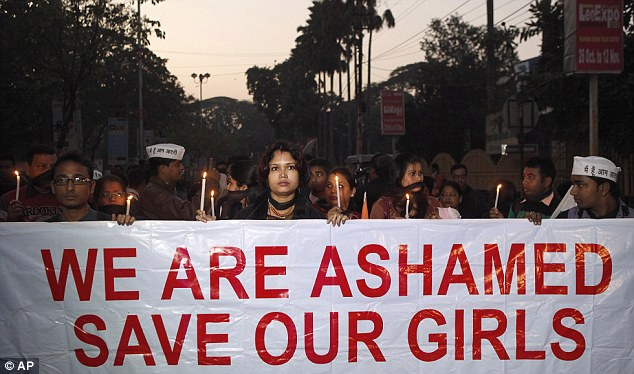 Anger: Indian women participate in a silent procession to mourn the death of the gang rape victim