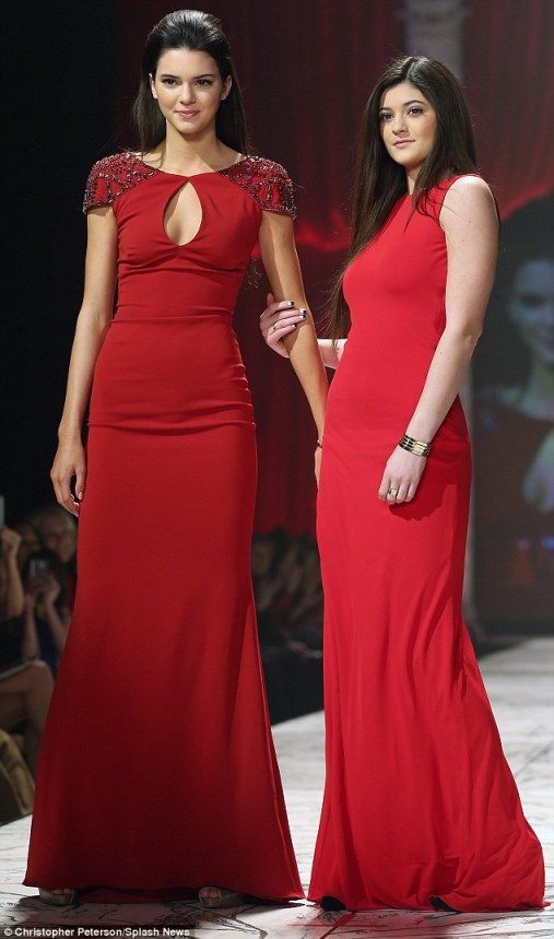 Catwalk queen: Kendall and Kylie looked stunning in their scarlet gowns