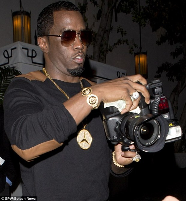 Conscientious Diddy man: The perfectionist made sure he checked his photos before letting them leave