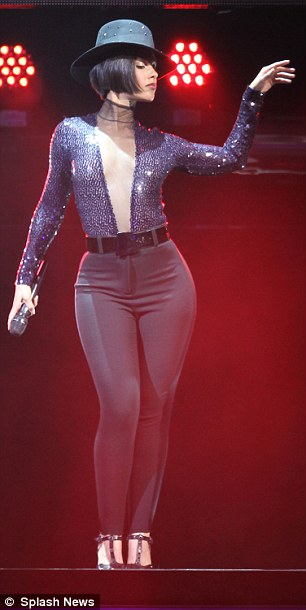 Racy: The mother-of-one teamed her sexy leotard with a more demure pair of high-waisted black cigarette pants, which showed off her enviably curvaceous figure in all its glory