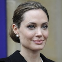 NEW WORLD ORDER GHOUL Angelina Jolie ...makes a sober appearance at G8 Summit VIDEO-ALEX JONES CALLS FOR JOLIE ARREST