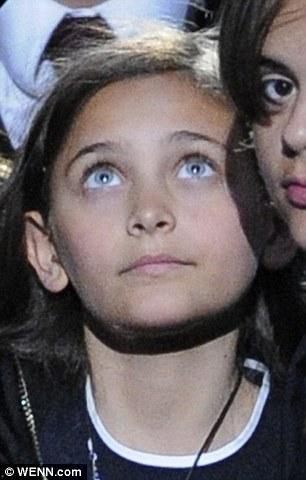 Similar features: Lester alleges his daughters Olivia and Harrett, pictured in 2009, resemble Jackson's daughter Paris, pictured in 2012