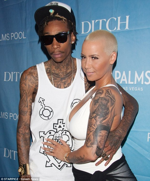 Engaged couple: Wiz and Amber got engaged in March 2012 and had a son in February