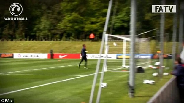 Vision: Lampard takes aim (above) and scores (below) during England training on Monday