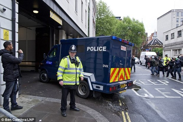Arriving at court: Detectives from the Metropolitan Police Service's Counter Terrorism Command said last night they have been authorised to charge him over the attack last Wednesday