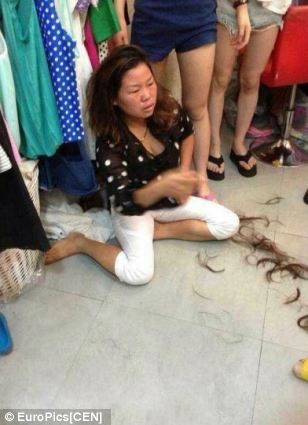 Vigilante justice: Chinese shopkeeper Lu Sun was so fed up with losing stock from her store to thieves that she decided to teach Li Wu (pictured) a lesson by pinning her down and cutting her hair off