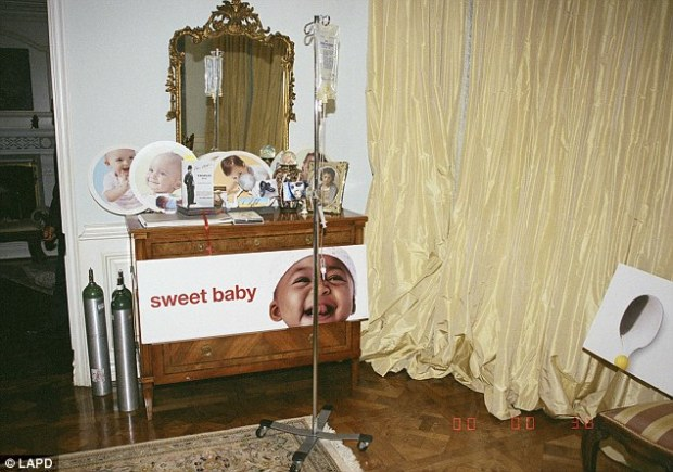 Unseen: New evidence pictures of Jackson's bedroom were released this week including this shot of an IV bag, oxygen canisters and a bizarre series of baby portraits