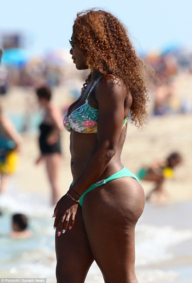 Dangerous curves: Serena showed off her shapely body in her bright green bikini