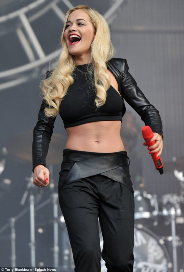 Abs of steel: Rita Ora displays her toned tummy onstage at North East Live