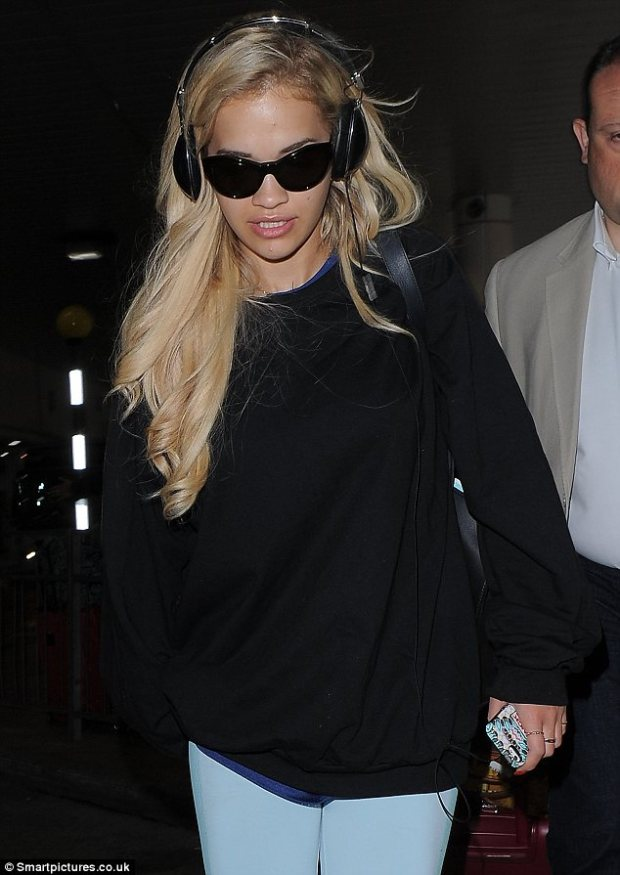 Holiday's over: Rita arrived back into the UK from LA after spending time with her boyfriend Calvin Harris