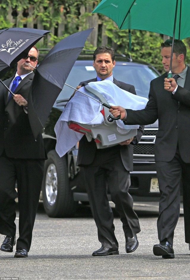 Sad occasion: James Galdofini's 8-month-old daughter Liliana Ruth Gandolfini is carried in to the wake