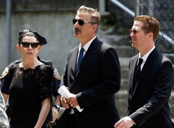 Star-studded: Actors Julianna Margulies, left, and Chris Noth, center, leave the star-studded funeral for the beloved actor