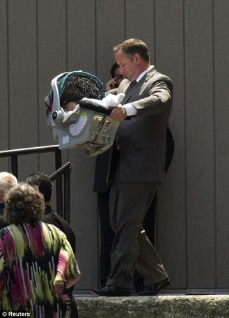 Baby: Gandolfini's 8-month-old daughter Lily is carried out of the service