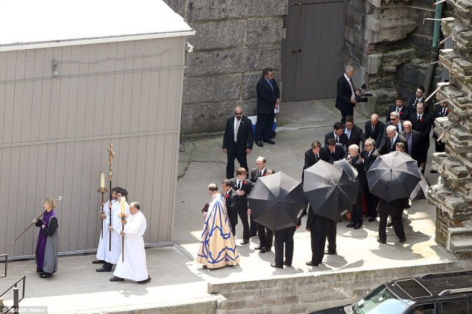 Procession: James Gandolfini's family is seen walking behind the coffin as the funeral service ends
